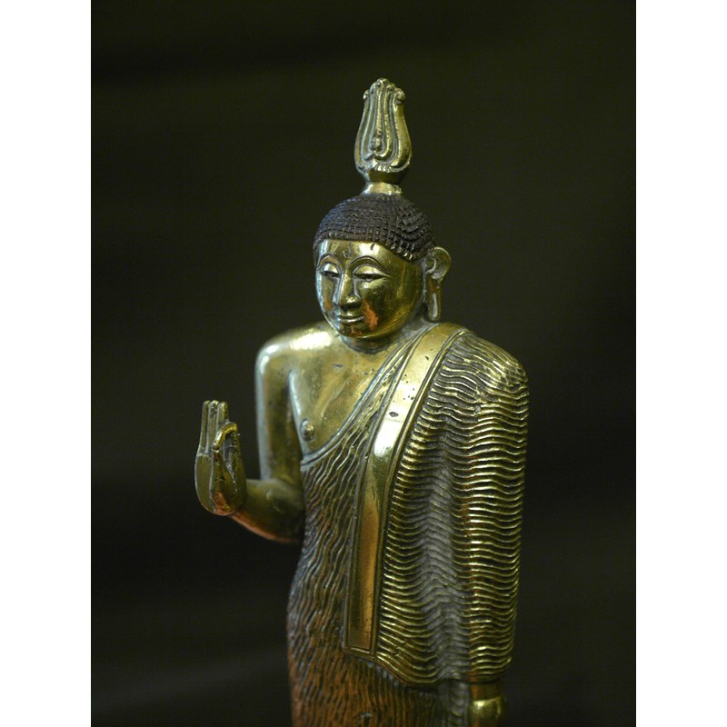 Extremely rare fire-gilt bronze Buddha from Kandy kingdom. Sri Lanka, middle 18th century.